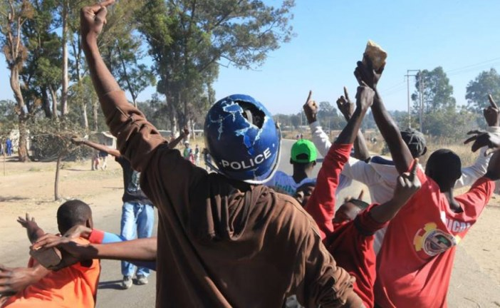Zimbabwe police fire teargas as protests turn violent