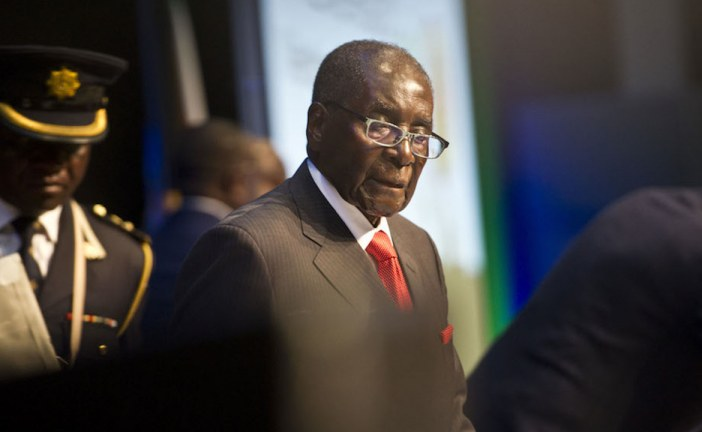 Robert Mugabe's government blocks WhatsApp as workers heed calls for stay away.