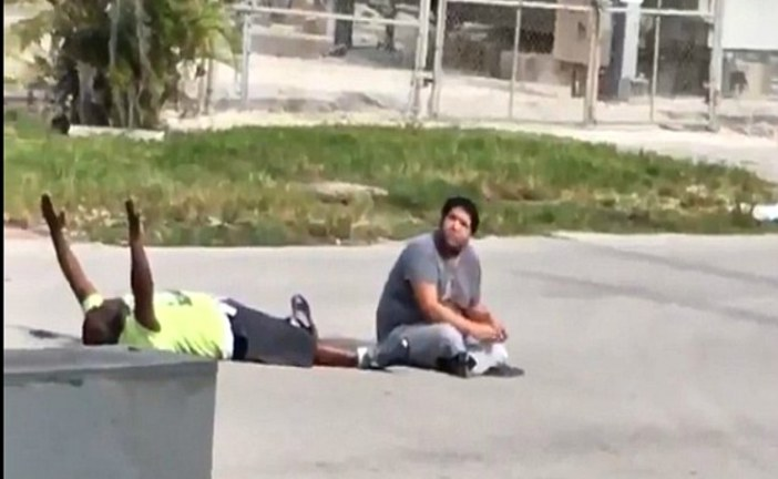 Video Shows Unarmed Black Man Pleading with Arms Raised Before Police Shoot Him