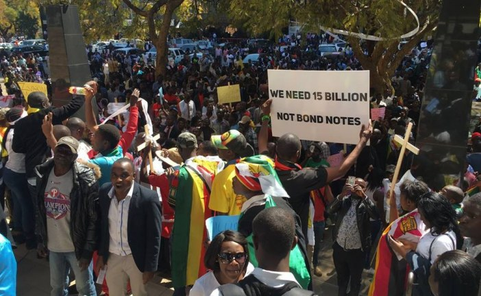 FURIOUS ZIMBABWEANS FLOOD HARARE STREETS IN PROTEST AGAINST BOND NOTES
