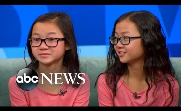 Chinese twin sisters meet for first time after being adopted by different US families