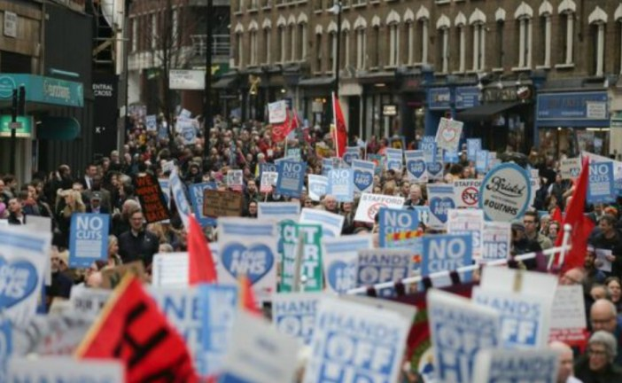 Tens of thousands march against 'hospital cuts' in the UK