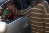 Street kid in Kenya approaches car to beg for money but got more than what he bargained for he  bursts into tears when he sees women inside