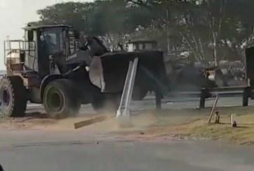 Bulldozer topples police van in South Africa