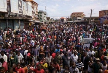Thousands of Guineans march against president Alpha Conde
