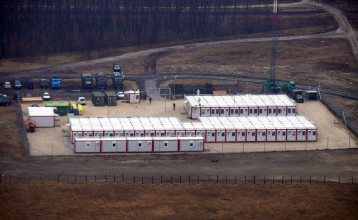 Poland to house asylum seekers in CONTAINERS under new plans
