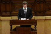 Catalonia's Carles Puigdemont suspends independence